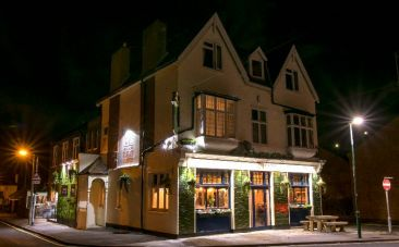 front of pub at night